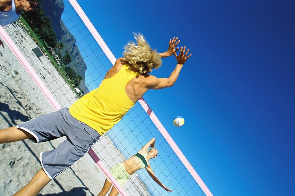 Male preparing to block volleyball : Stock Photo