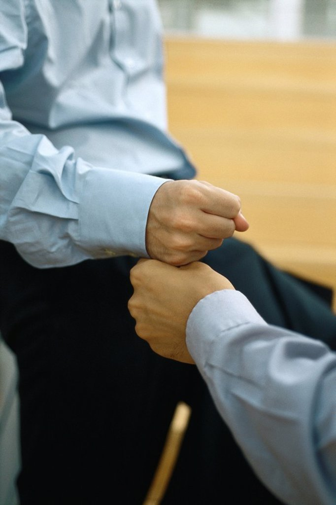 Two men touching fists : Stock Photo