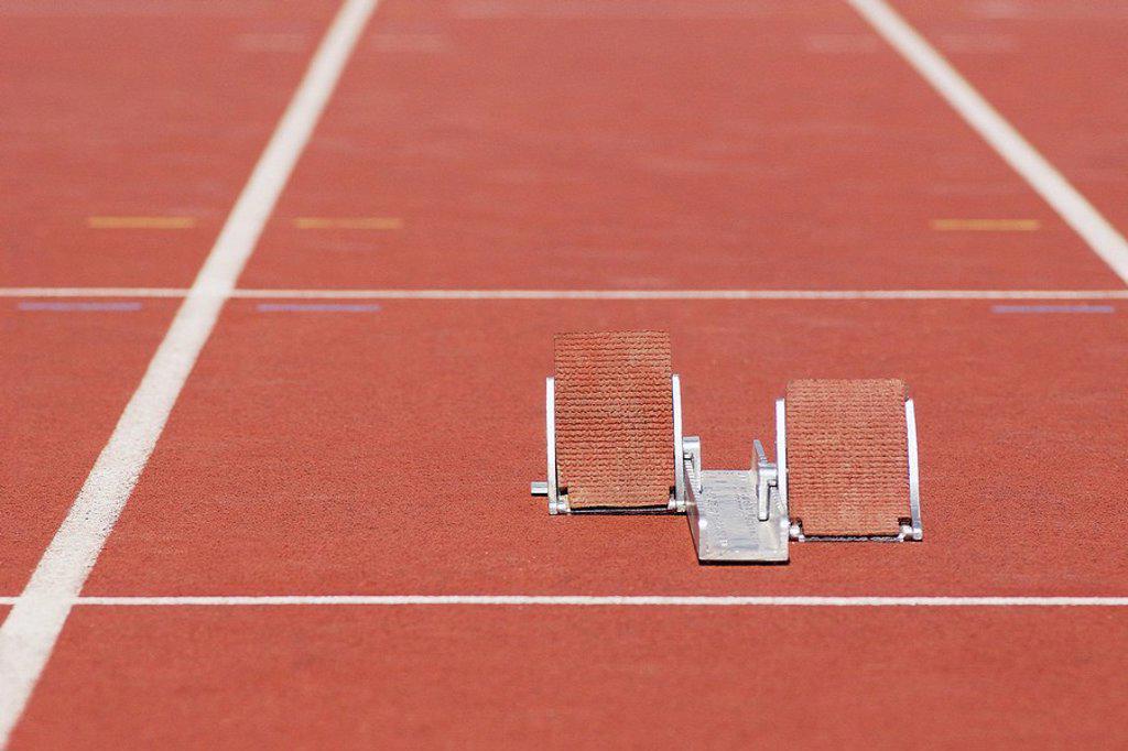 Starting blocks on running track : Stock Photo