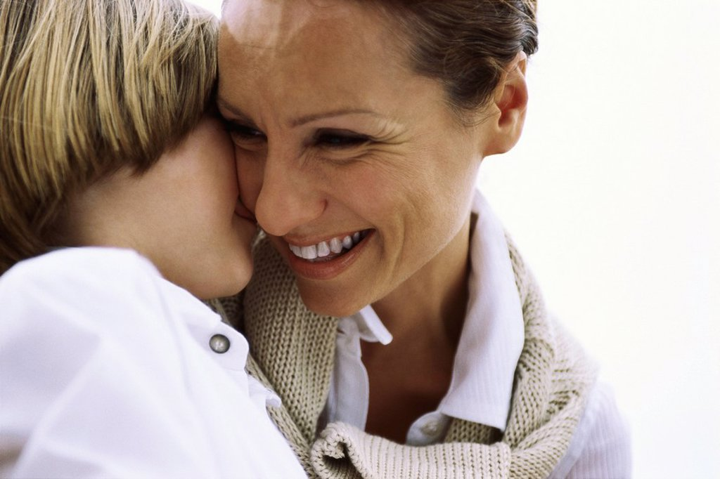 Mother and young son affectionately embracing : Stock Photo
