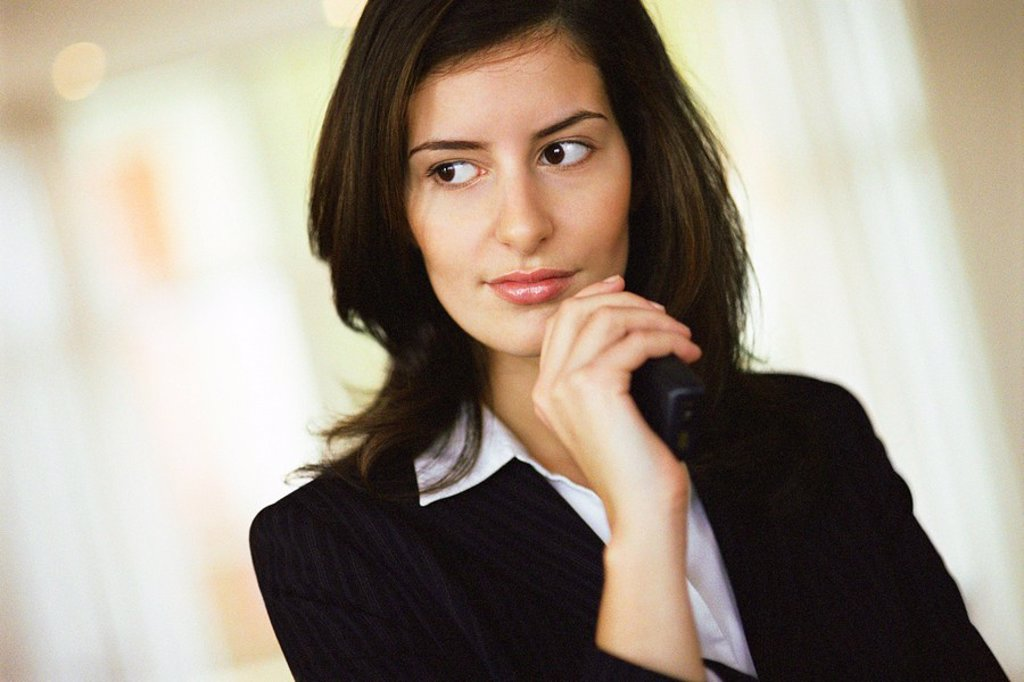 Stock Photo: 1569R-9055826 Businesswoman looking away in thought, portrait