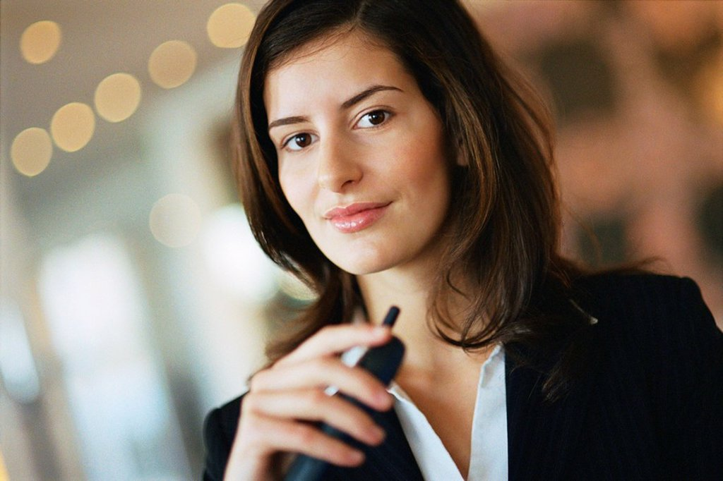 Young businesswoman smiling at camera, portrait : Stock Photo