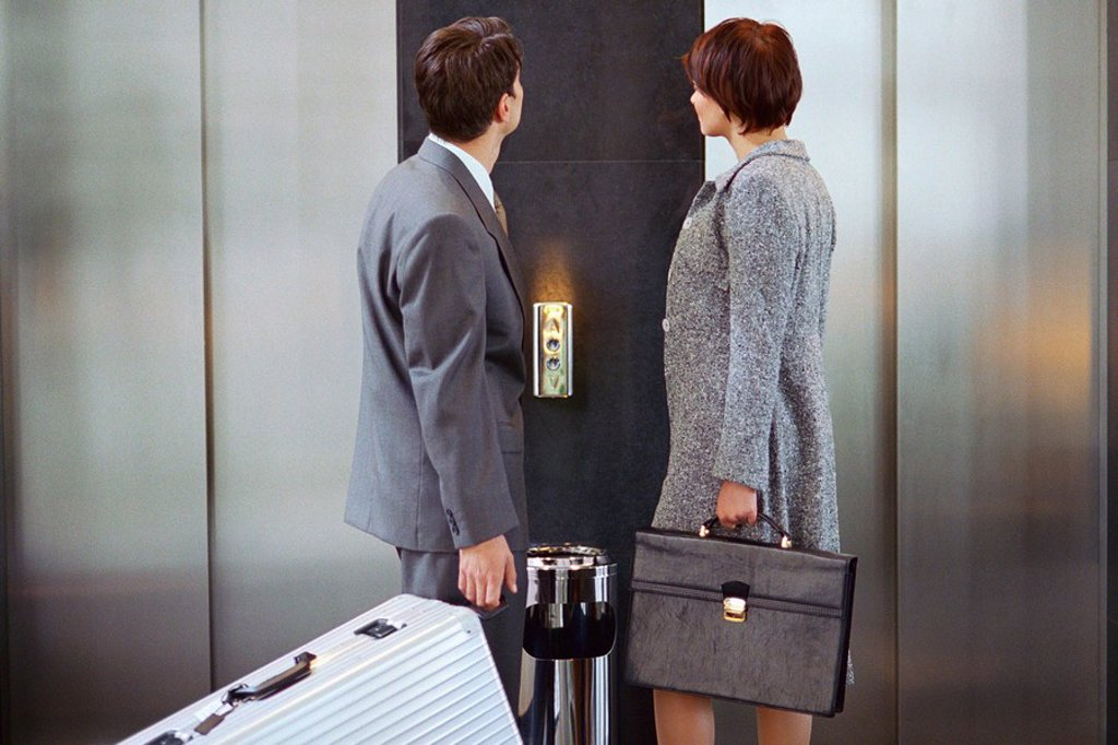Stock Photo: 1569R-9055847 Business associates waiting for elevator