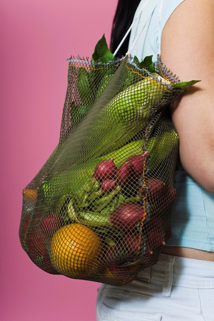 Sack of fresh vegetables carried over shoulder : Stock Photo