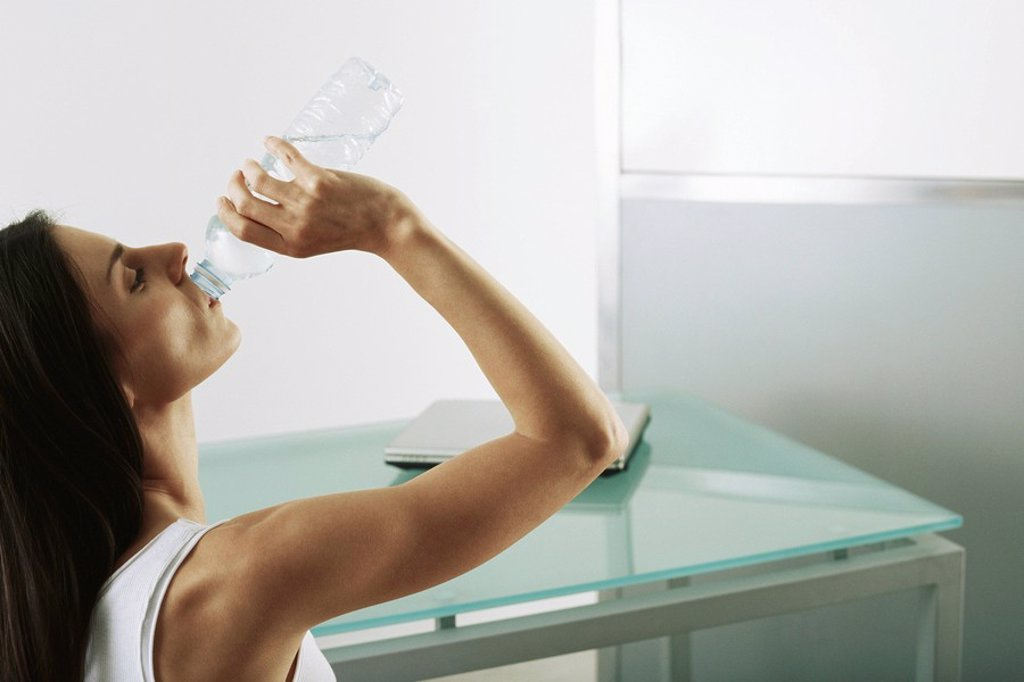 Woman quenching thirst : Stock Photo