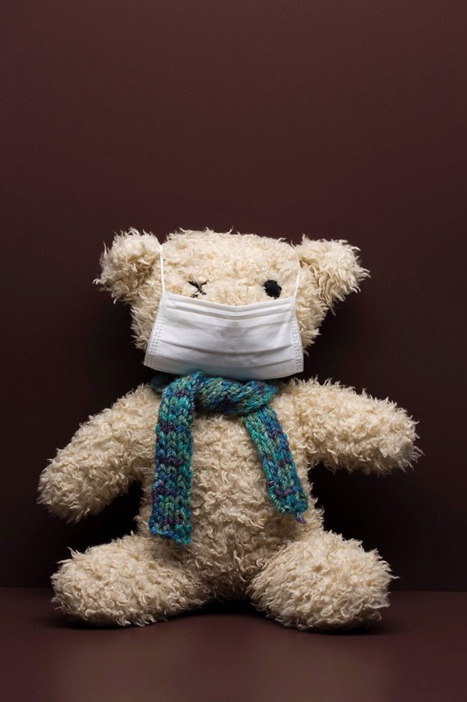Teddy bear wearing flu mask : Stock Photo