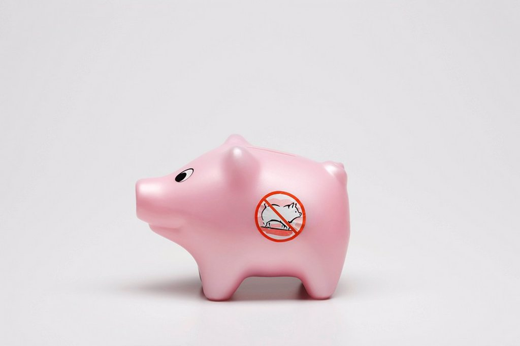 Stock Photo: 1569R-9056421 Swine flu concept, toy pig with no pigs symbol on side