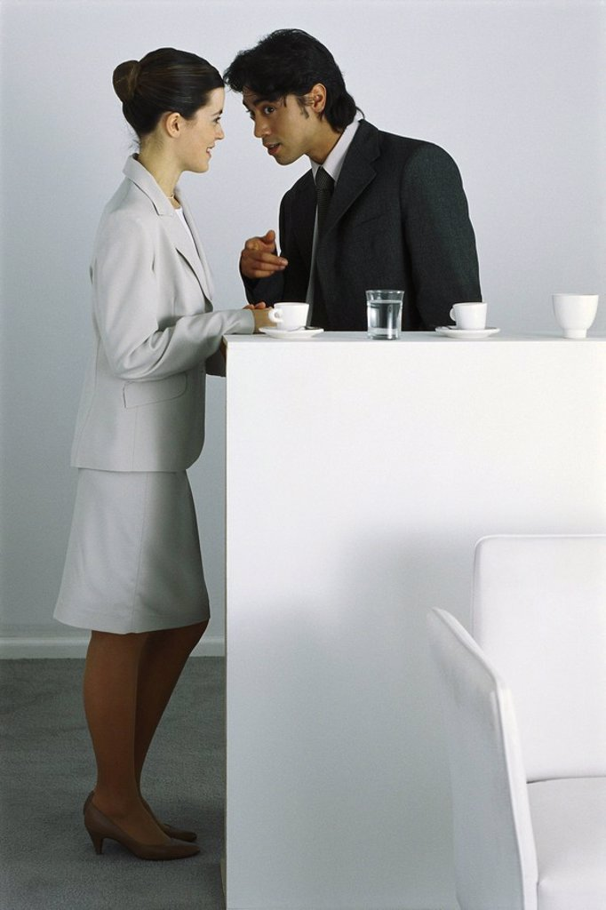 Stock Photo: 1569R-9056570 Male and female colleagues having coffee break together, gossiping