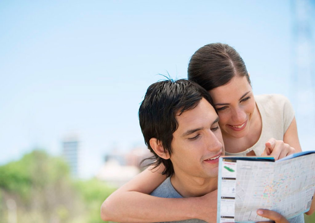 Stock Photo: 1569R-9056843 Young couple looking at map