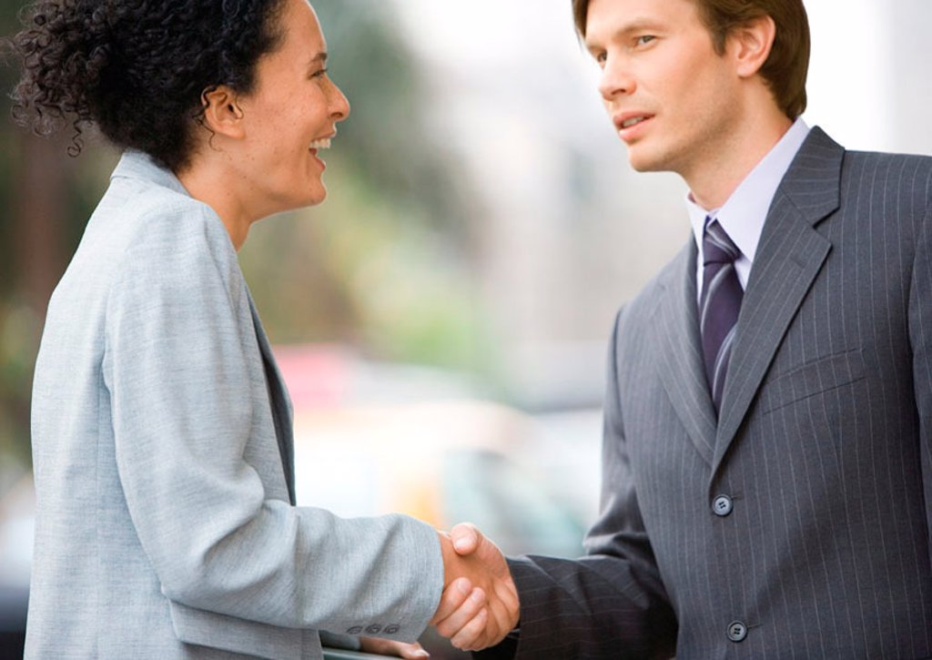 Stock Photo: 1569R-9056947 Businesswoman and businessman shaking hands