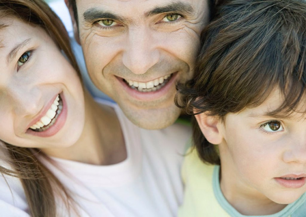 Father with two children, boy looking away, father and daughter smiling and looking at camera, portrait, close-up : Stock Photo
