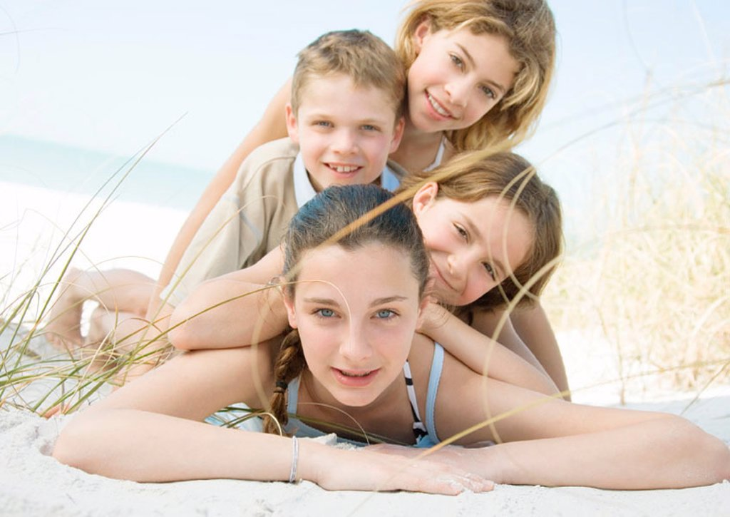 Stock Photo: 1569R-9058918 Kids lying on beach, portrait