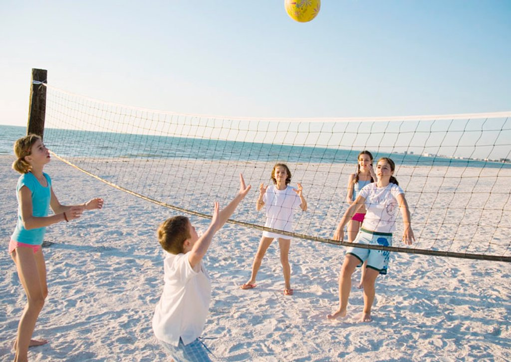 Stock Photo: 1569R-9058929 Group of kids playing beach volleyball