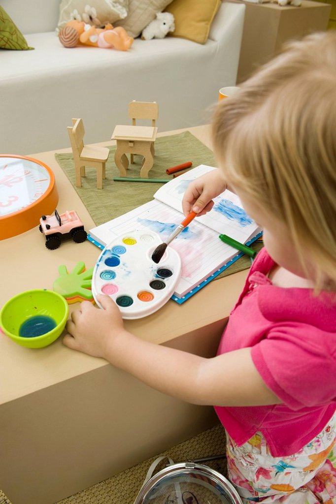 Little girl painting with watercolors : Stock Photo