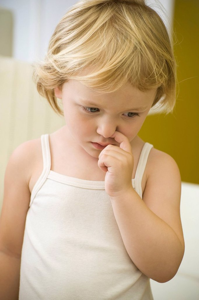 Stock Photo: 1569R-9064993 Little girl picking nose