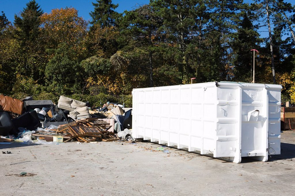 Junk piled up beside dumpster : Stock Photo