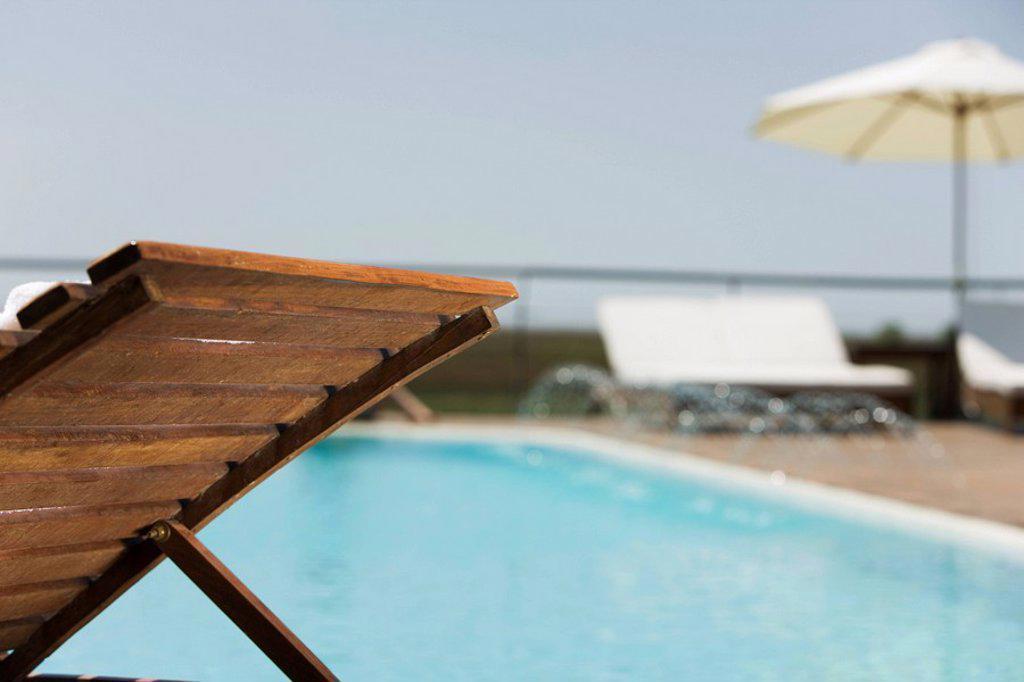 Poolside deckchair : Stock Photo