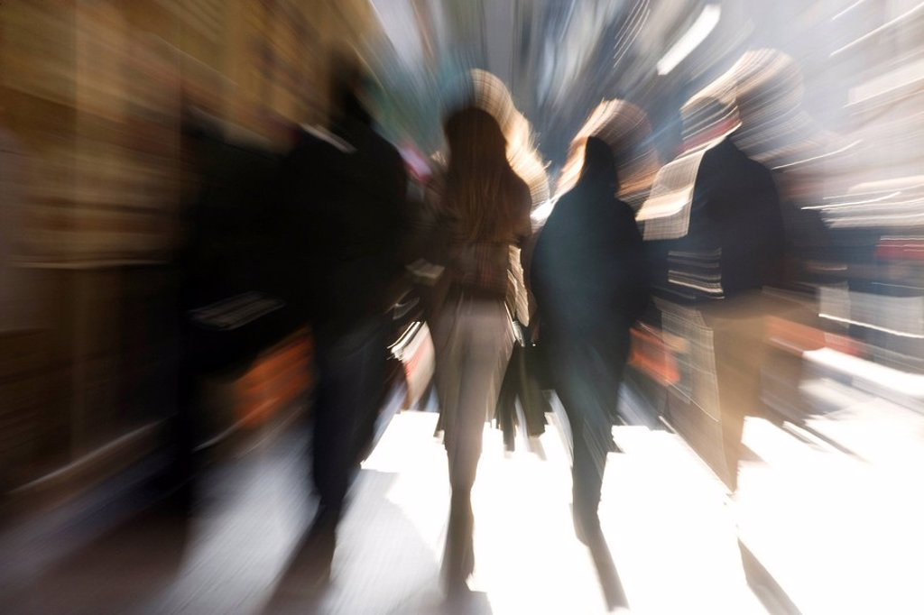 Pedestrians walking, rear view, blurred : Stock Photo