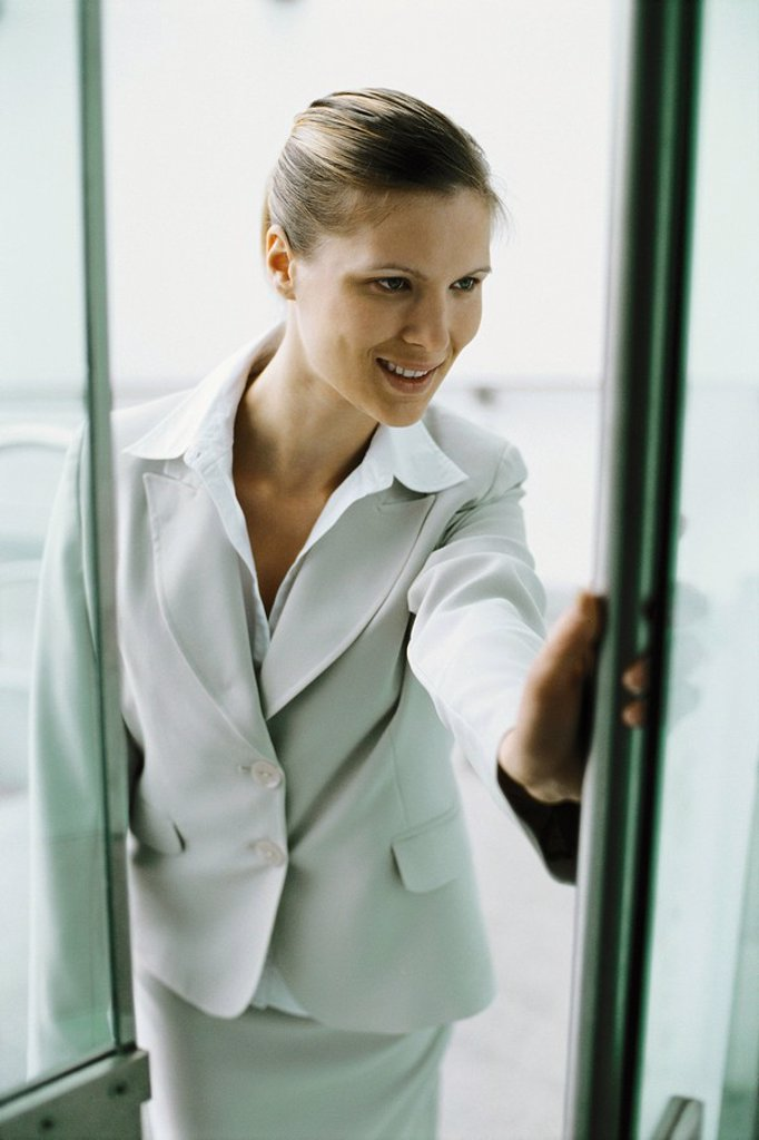 Stock Photo: 1569R-9067132 Businesswoman entering building