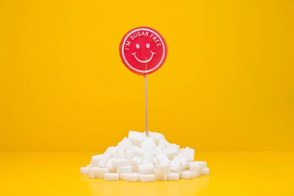 Stock Photo: 1569R-9067266 Food concept, sugar_free lollipop sticking out of pile of sugar cubes
