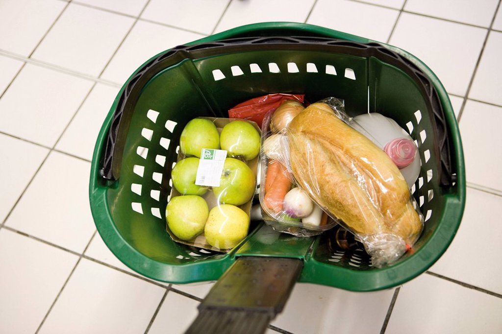 Shopping basket containing groceries : Stock Photo