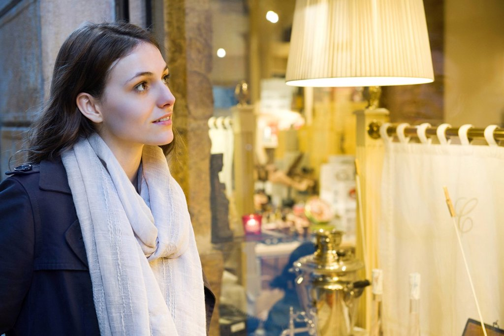 Stock Photo: 1569R-9067959 Young woman window shopping