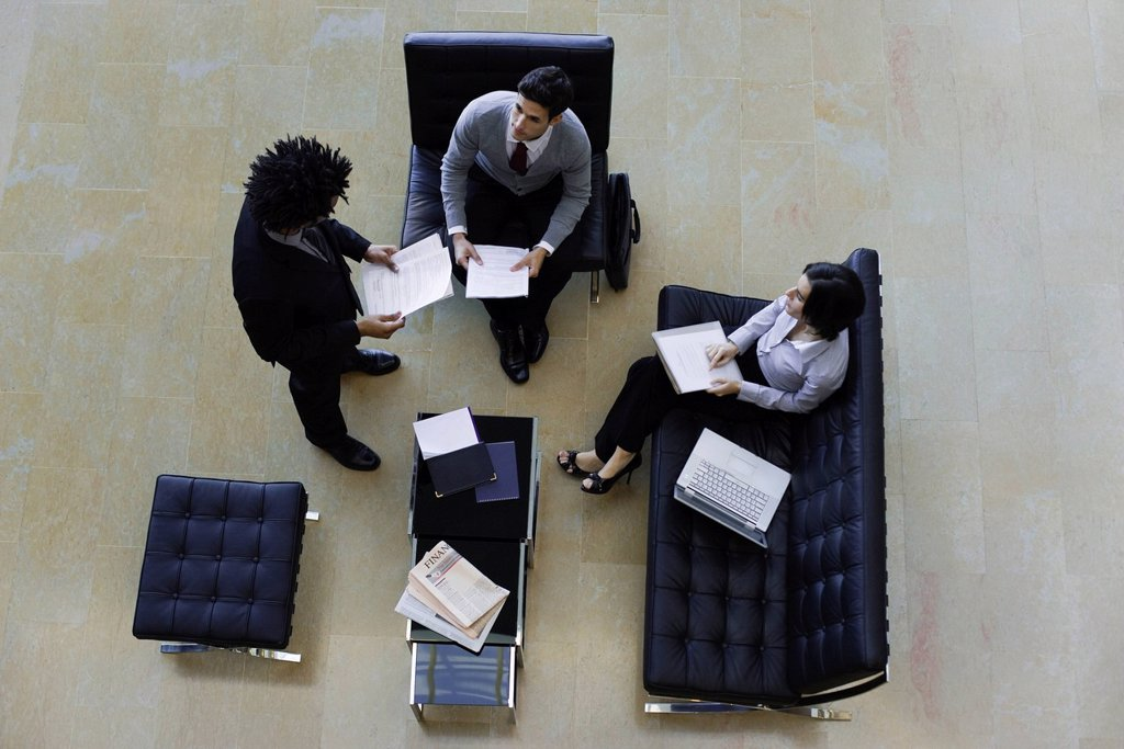 Executives working together, overhead view : Stock Photo