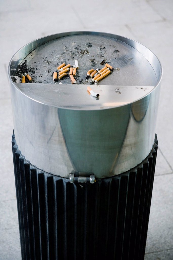 Garbage can with cigarette butts : Stock Photo