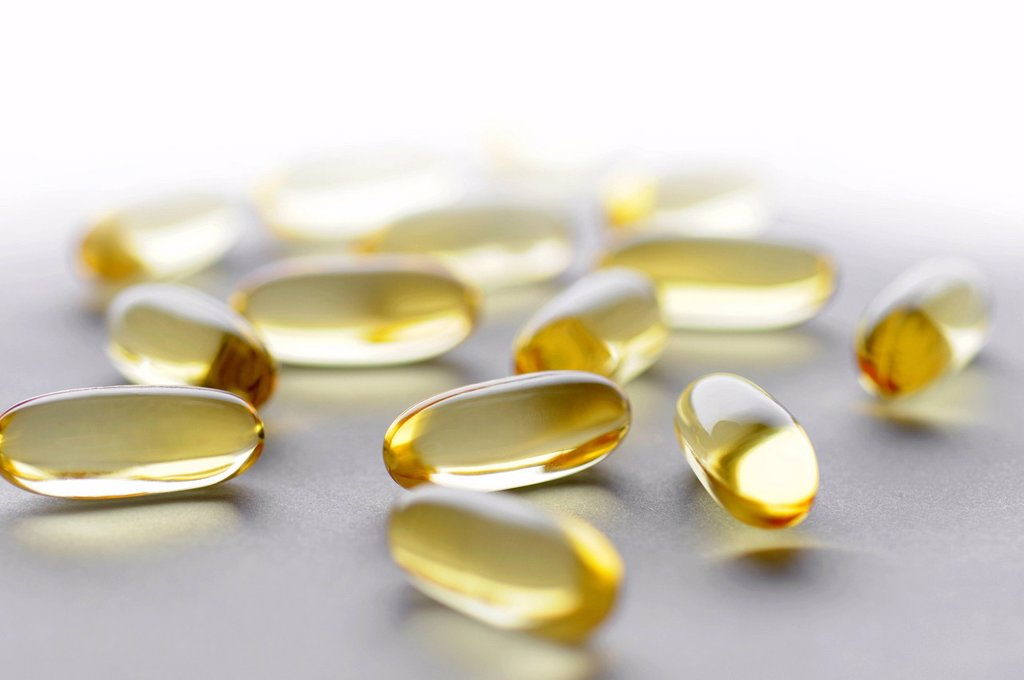 Stock Photo: 1569R-9068411 Cod liver oil capsules