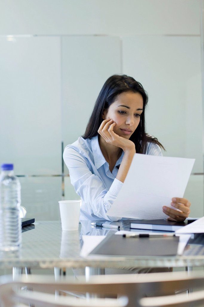 Businesswoman reading document : Stock Photo