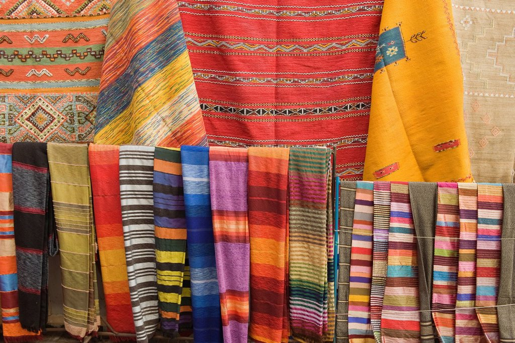 Brightly colored textiles, full frame : Stock Photo