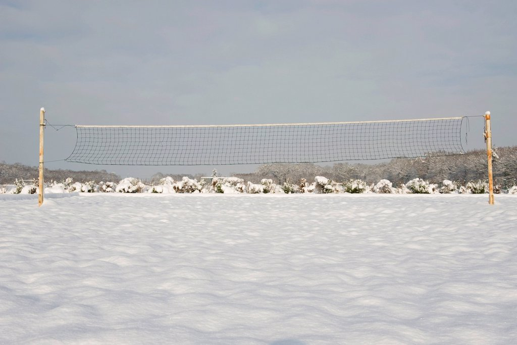 Stock Photo: 1569R-9068768 Sports net in snow_covered field