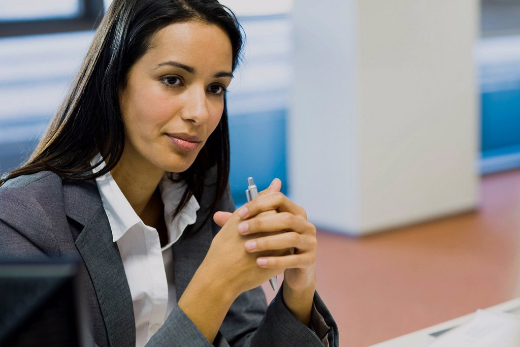 Businesswoman looking away in thought, portrait : Stock Photo