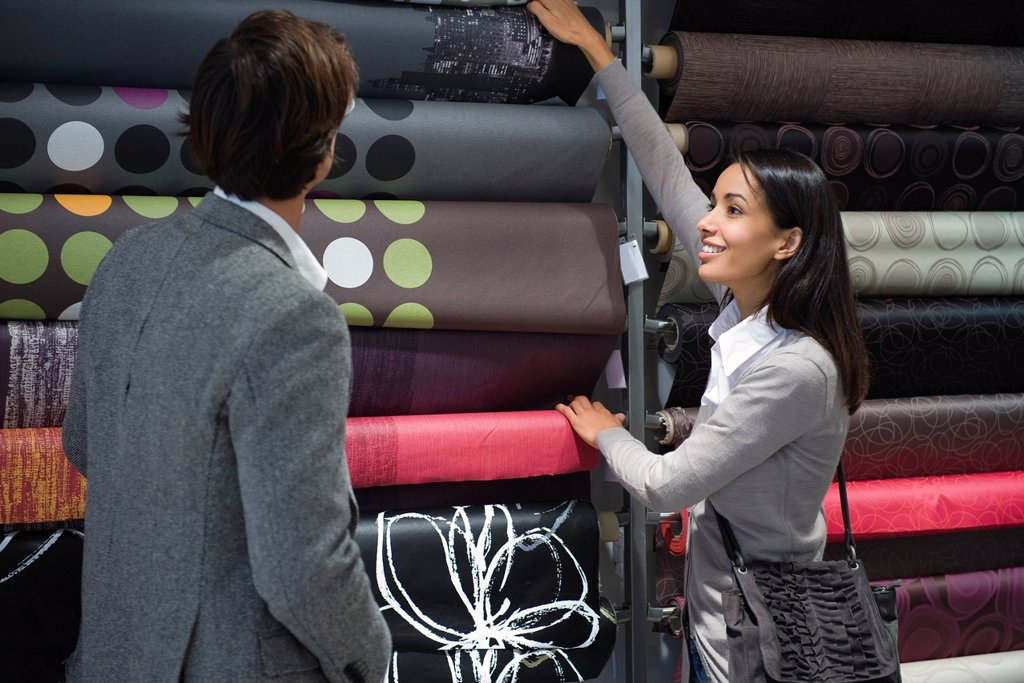 Stock Photo: 1569R-9069077 Couple shopping for fabric