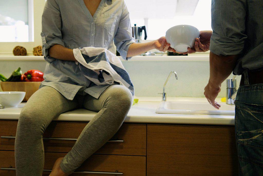Couple washing dishes together : Stock Photo