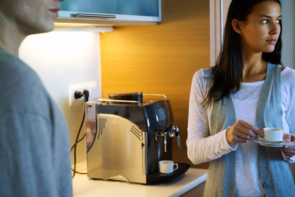 Woman enjoying cup of coffee in kitchen : Stock Photo