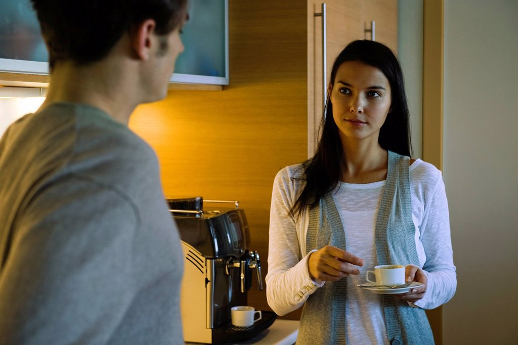 Couple enjoying coffee in kitchen : Stock Photo