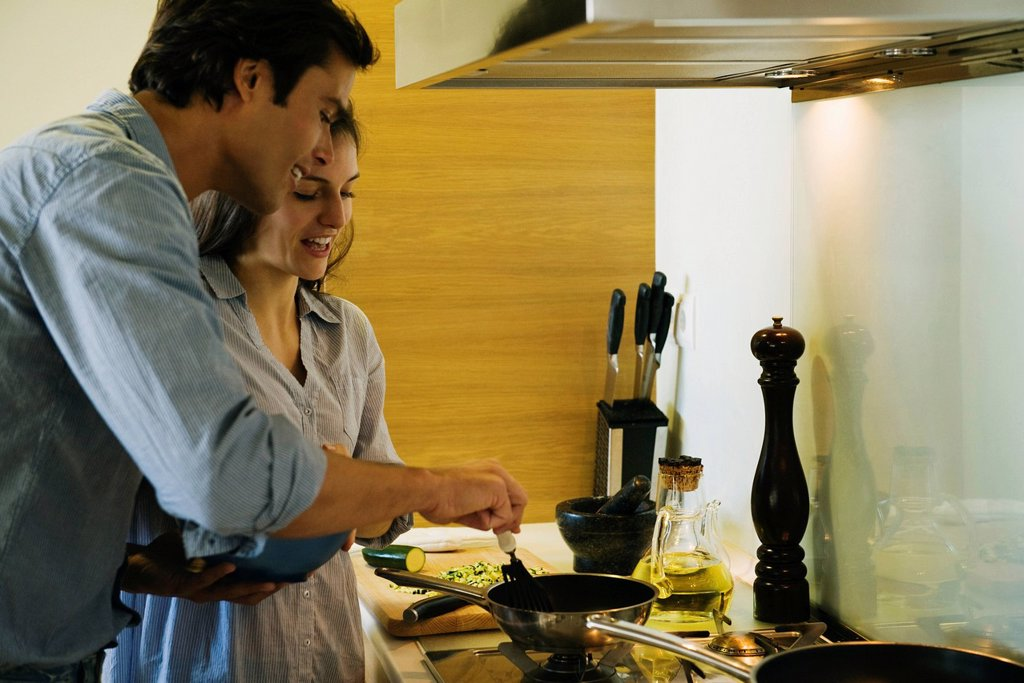 Stock Photo: 1569R-9069181 Couple cooking together