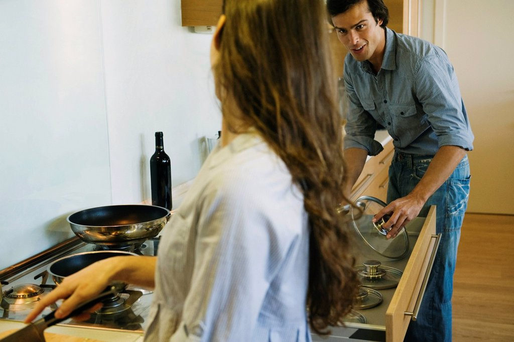 Couple cooking together : Stock Photo