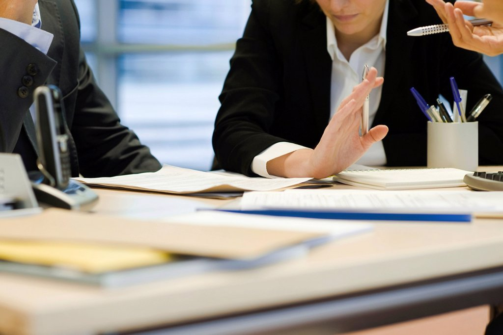Executives in meeting, cropped : Stock Photo