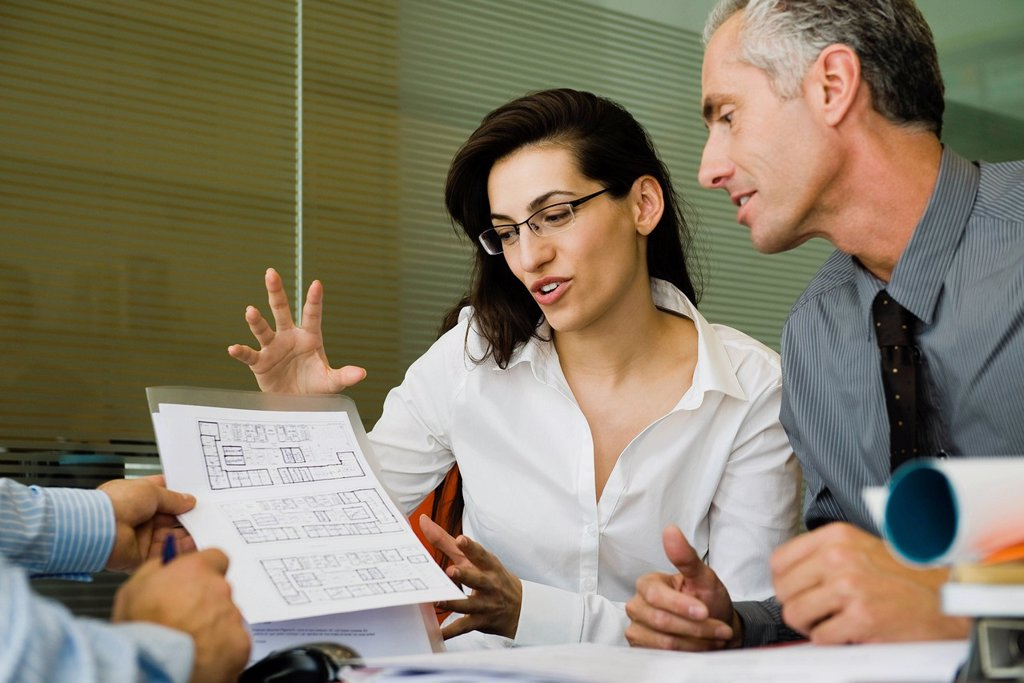 Business people discussing blueprint : Stock Photo