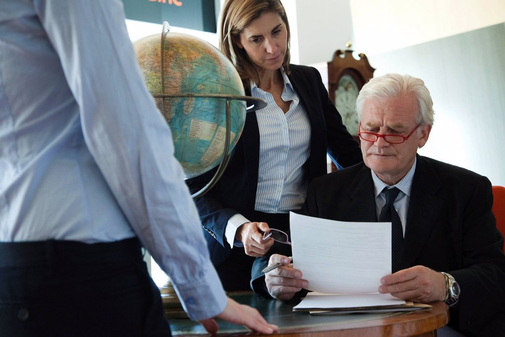 Stock Photo: 1569R-9069783 Executives discussing document