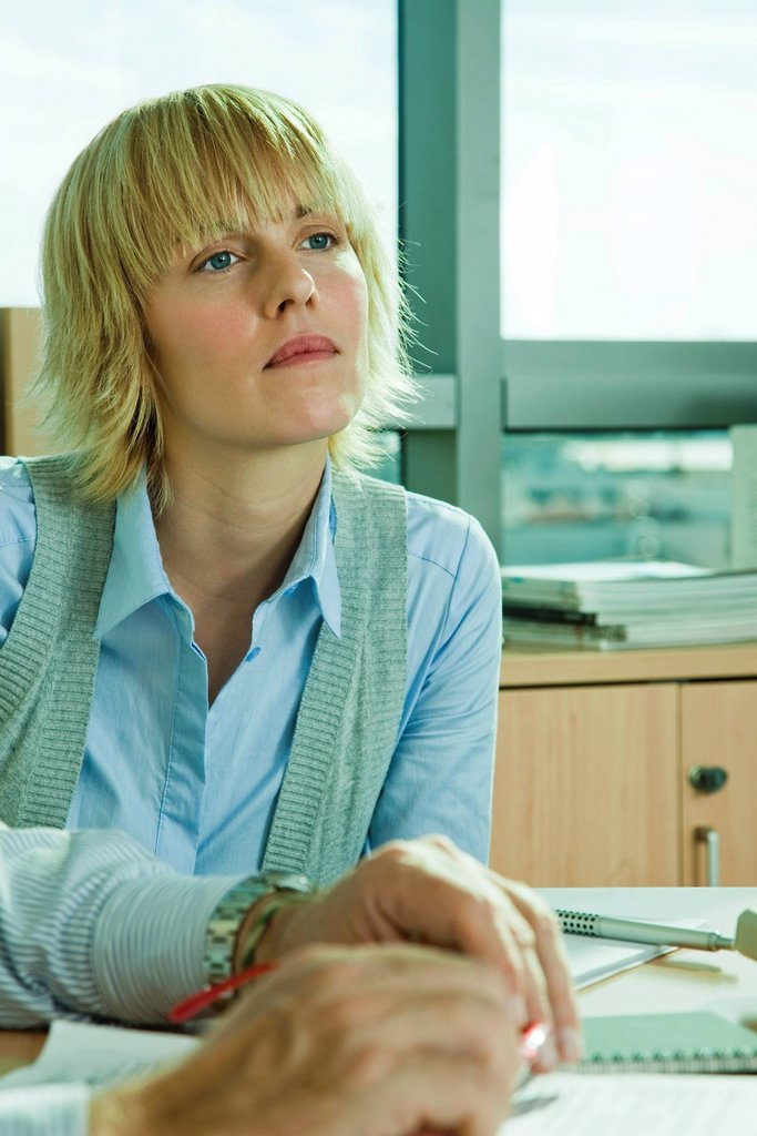 Executive looking away in thought : Stock Photo