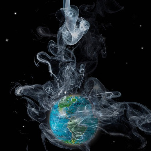 Stock Photo: 1569R-9069975 Planet earth shrouded in smoke