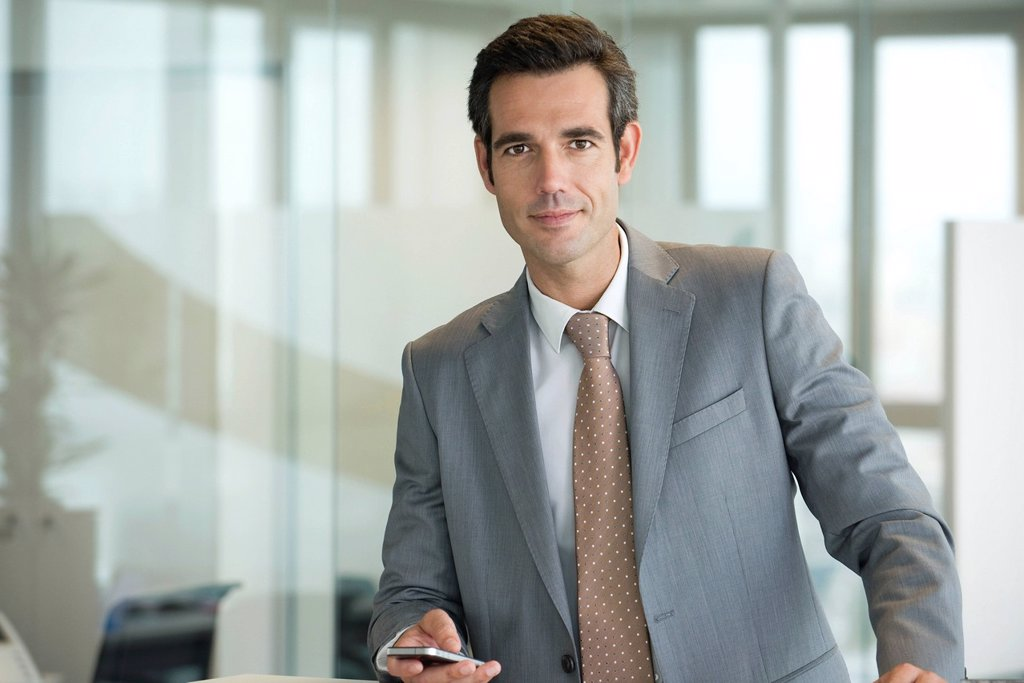 Stock Photo: 1569R-9070007 Male executive using cell phone, portrait