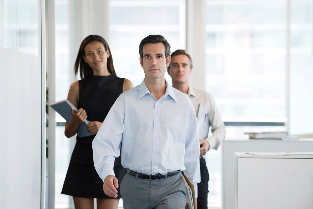 Executives walking in office : Stock Photo