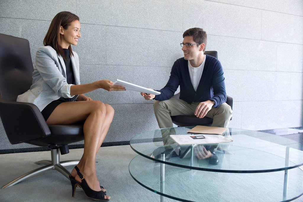 Businesswoman handing documents to client : Stock Photo