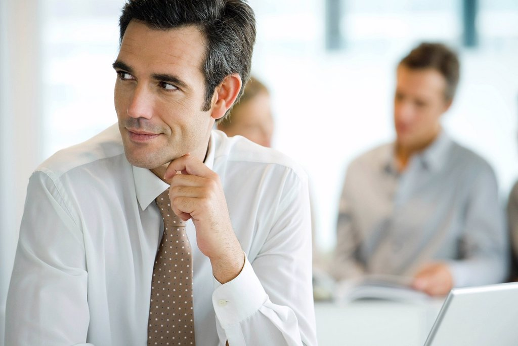 Stock Photo: 1569R-9070114 Businessman looking away in thought