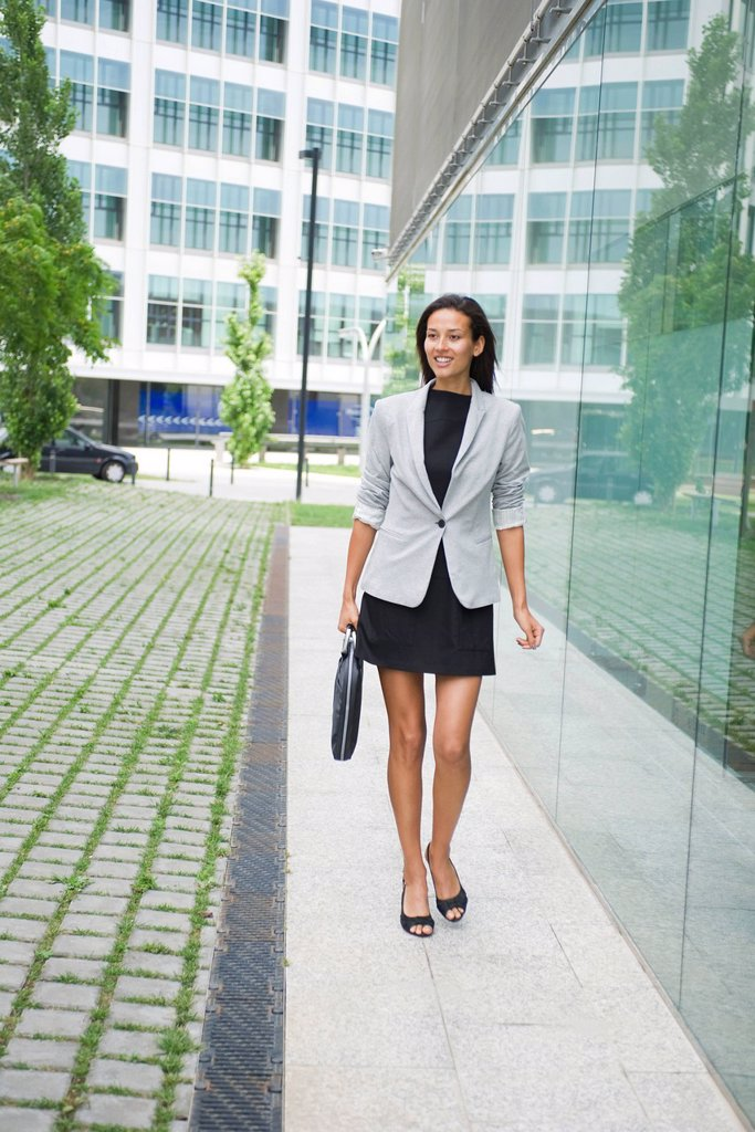 Stock Photo: 1569R-9070146 Businesswoman walking with briefcase