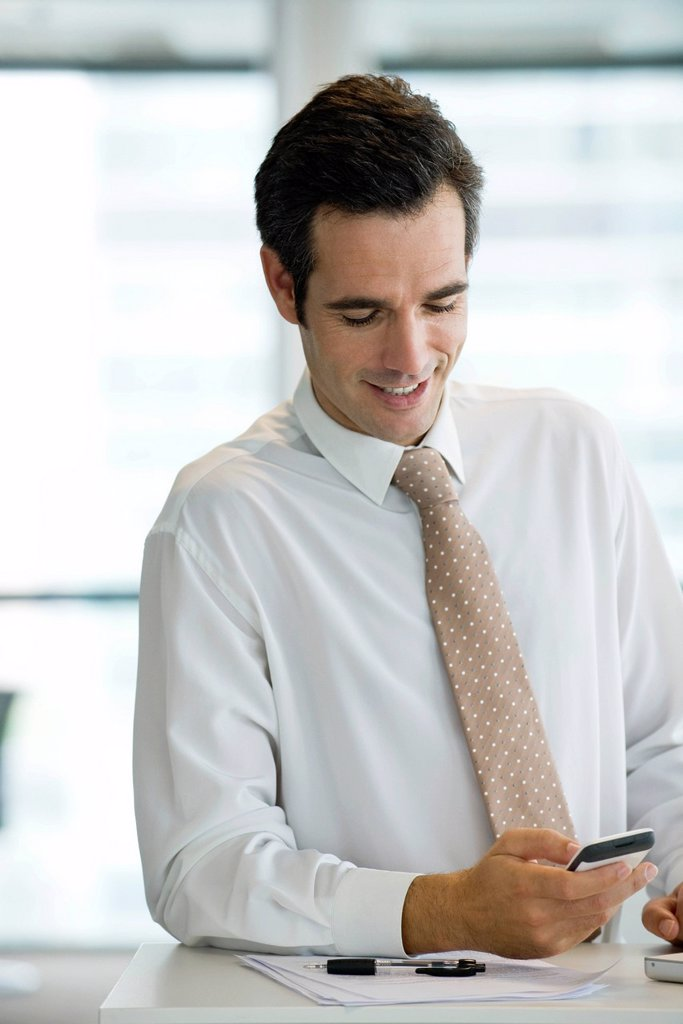 Stock Photo: 1569R-9070201 Businessman text messaging